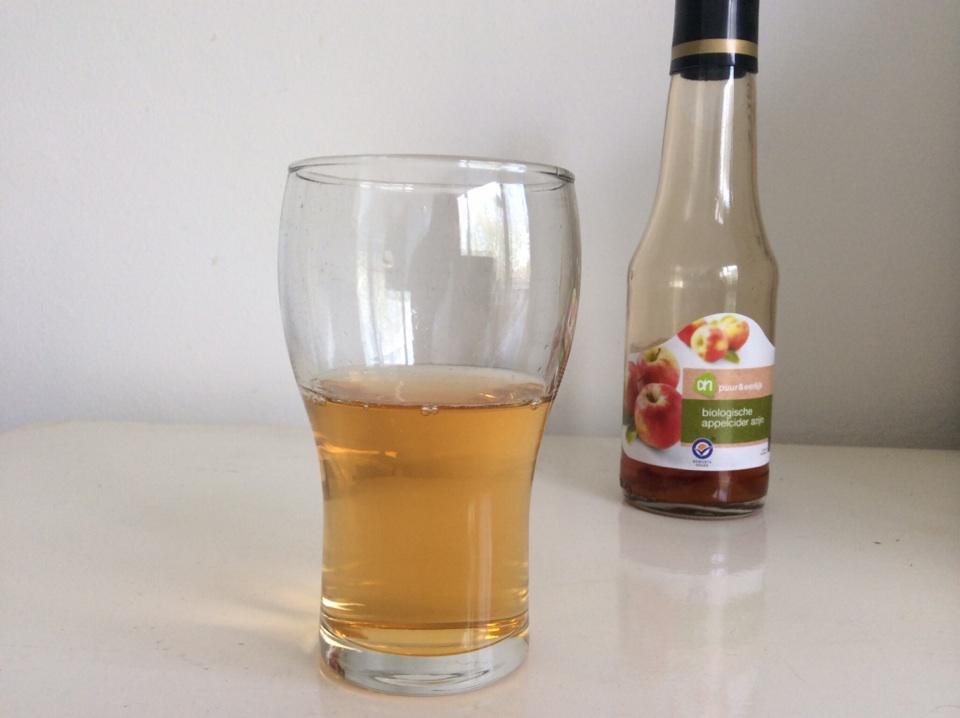 Lange gezonde lokken zonder shampoo appelciderazijn gemengd